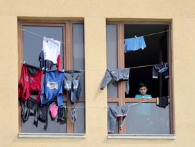 Laundry hangs to dry up as a Palestinian boy looks out of Al-Mathaf Hotel, where he is quarantined with others, amid concerns about the spread of the coronavirus disease, in the northern Gaza Strip April 6, 2020.