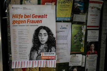 A poster at the entrance to a shop advertises the number for a helpline for women targeted by violence during the coronavirus pandemic. Berlin, April 7, 2020
