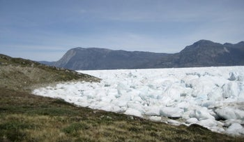 Greenland's ice sheet is seen breaking up as climate change continues.