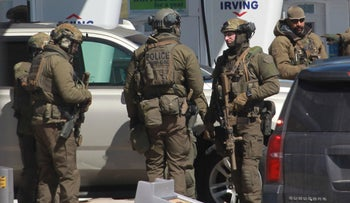 Members of the Royal Canadian Mounted Police tactical unit confer after the suspect in a deadly shooting rampage was neutralized at in Nova Scotia, Canada, on April 19, 2020