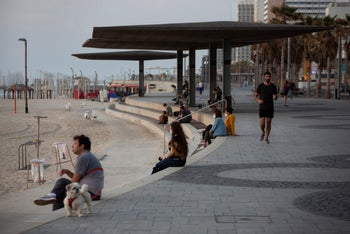 Watching the sunset on Tel Aviv's seaside promenade after coronavirus restrictions were eased, April 19, 2020.