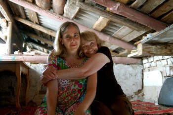 Fran Letzter Malkin embracing her daughter Debbie in the pigsty where she hid for nearly two years during the war.