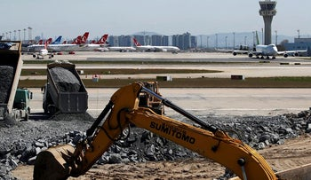 Construction vehicles work next to the tarmac of Ataturk Airport at a construction site of a hospital for coronavirus disease (COVID-19) treatment, in Istanbul, Turkey, April 9, 2020