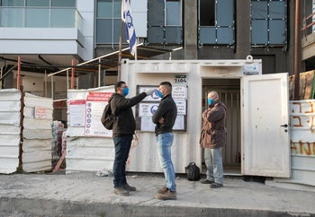 Construction workers getting their temperatures checked in Tel Aviv, March 30, 2020.