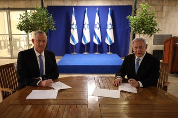 Benny Gantz and Benjamin Netanyahu at the prime minister's residence after signing the coalition deal, April 20, 2020.