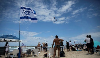 People watching the Air Force flyover marking Israel's Independence Day in 2019, Tel Aviv, Israel.