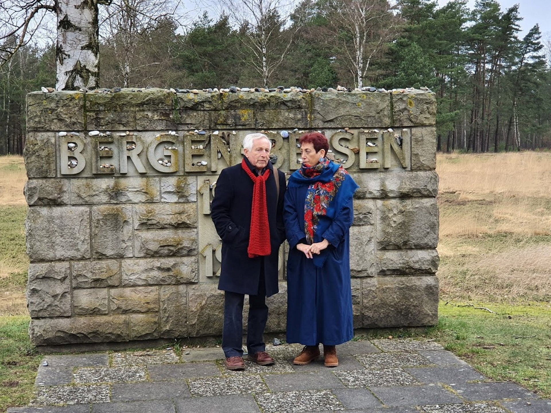 Dimbleby's son, Jonathan Dimbleby, next to my mother and Tzipora Singer's daughter, Liora Danieli, during our visit to Bergen-Belsen this year.