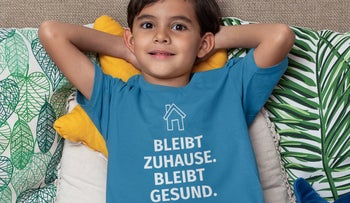 A youngster wearing a T-shirt telling fellow Germans to stay at home during the coronavirus lockdown.