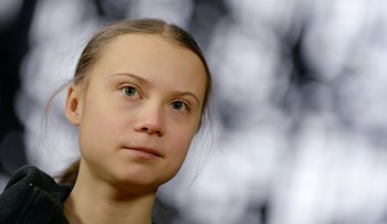Swedish climate activist Greta Thunberg talks to the media before meeting with EU environment ministers in Brussels, Belgium, March 5, 2020.