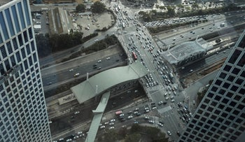A view from the top of an Azrieli Tower at traffic jams down  below, Kaplan intersection