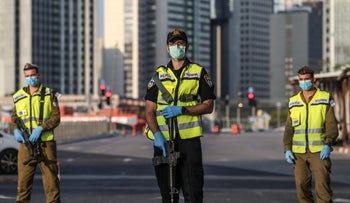 Israeli police officers block main roads at the entrance to a Tel Aviv suburb to curb the spread on the coronavirus, Ramat Gan, April 14, 2020.