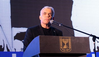 Yesh Atid Chairman Yair Lapid speaks at a pro-democracy protest in Tel Aviv, April 19, 2020.