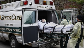 A patient is loaded into an ambulance by emergency medical workers outside Cobble Hill Health Center in Brooklyn, April 17, 2020.