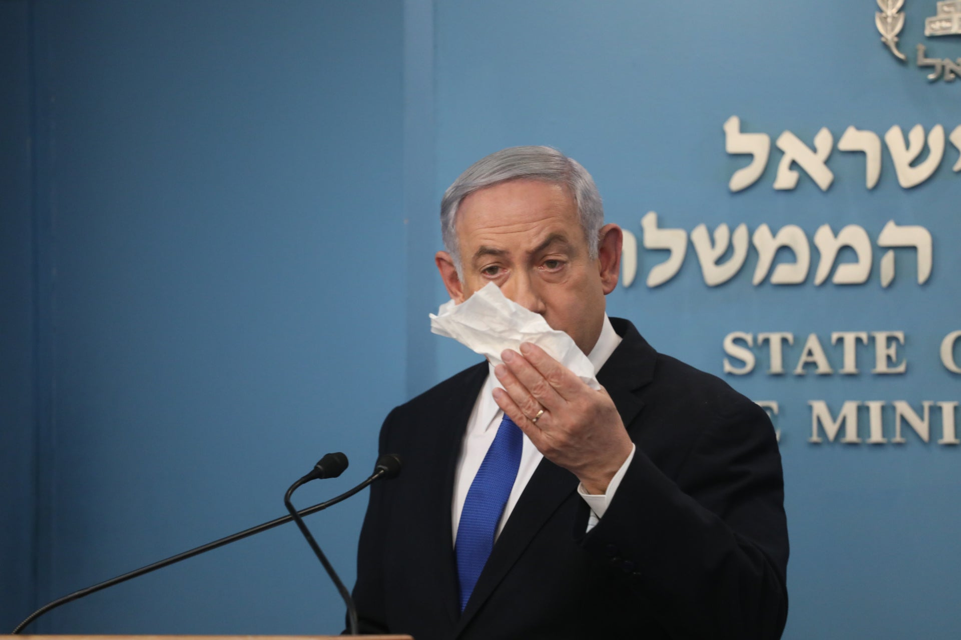 Netanyahu demonstrates how to use a tissue during a coronavirus briefing.