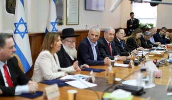 Ministers at a cabinet meeting on March 8, 2020.