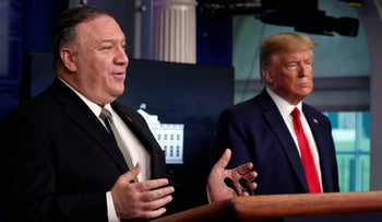 President Donald Trump listens as Secretary of State Mike Pompeo speaks about the coronavirus in the James Brady Press Briefing Room of the White House, Washington, April 8, 2020.