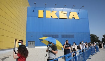 People queuing outside an Ikea store after it reopened following a coronavirus lockdown, in Netanya, Israel, April 21, 2020.