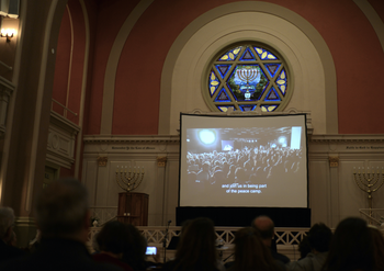 The congregants at a synagogue in Washington D.C. watch the joint Israeli-Palestinian Memorial Day ceremony held in Tel Aviv in 2018.