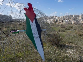 Protesters post a placard that reads 'Jerusalem is the eternal capital of Palestine' in the West Bank village of Bilin, near Ramallah, Friday, Jan. 31, 2020