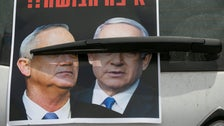 A poster showing Benjamin Netanyahu and Benny Gantz on a car in Tel Aviv, April 24, 2020.