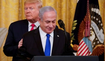 Donald Trump puts his hands on Benjamin Netanyahu's shoulders as they deliver joint remarks on a Middle East peace plan proposal in the East Room of the White House, January 28, 2020.