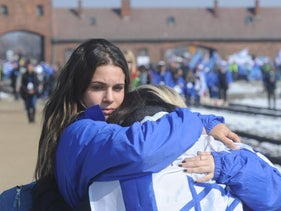 Girls hugging during the March of the Living, Auschwitz-Birkenau, April 8, 2013