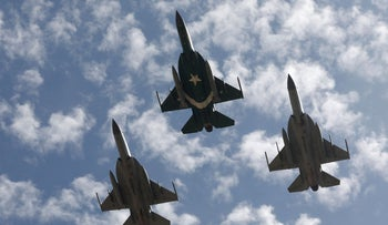 Pakistan Air Force JF-17 Thunder jets perform an aerial display in Karachi to commemorate the force's downing of an Indian military plane over Kashmir a year before. Feb 27, 2020