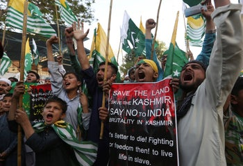 Pakistani students shout slogans against India during a solidarity rally with pro-independence Indian Kashmiris. Karachi, Pakistan, March 6, 2020