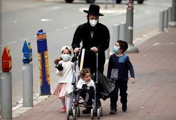 An ultra-Orthodox Jewish family wearing masks walking in Bnei Brak, the Haredi town badly affected by the coronavirus. Israel April 5, 2020