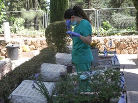 A woman visits the cemetery at Mount Herzl, April 28, 2020.