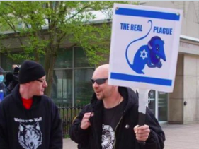 Anti-Semitic sign held by a protester at the Columbus, Ohio anti-lockdown demonstration. April 18, 2020