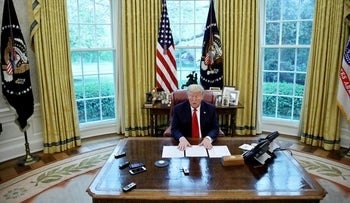 U.S. President Donald Trump answers questions about China and the coronavirus pandemic in the Oval Office of the White House in Washington, U.S., April 29, 2020.