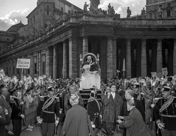 Pope Pius XII salutes worshipers at St. Peter's Square in The Vatican.