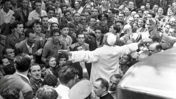 Pope Pius XII during a visit to a bombed-out area of Rome, Italy, in 1943.