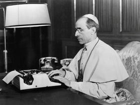 Pope Pius XII in his office in the Vatican.