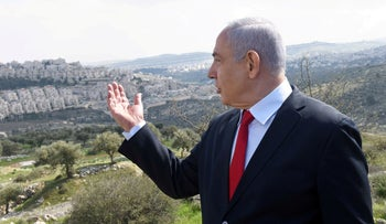Netanyahu stand in front of the Israeli settlement of Har Homa, located in an area of  West Bank, February 20, 2020