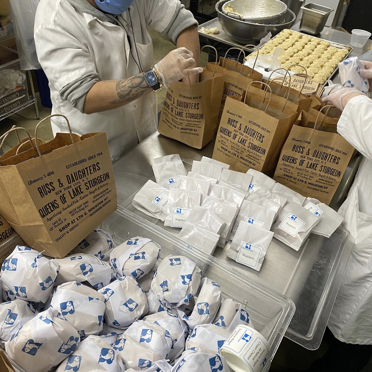 Packaging food at Russ & Daughters. As of last week, the family still had 50 working employees and was offering delivery.
