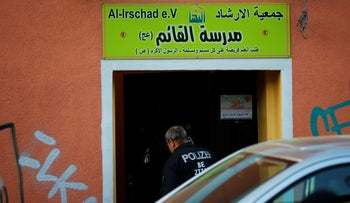 German special police enter the El-Irschad center in Berlin after Germany banned Iran-backed Hezbollah on its soil and designated it a terrorist organization, April 30, 2020.