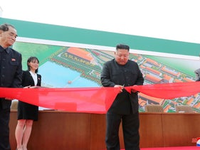 North Korean leader Kim Jong Un attends the completion of a fertiliser plant, together with his younger sister Kim Yo Jong, in a region north of the capital, Pyongyang, on May 2, 2020.