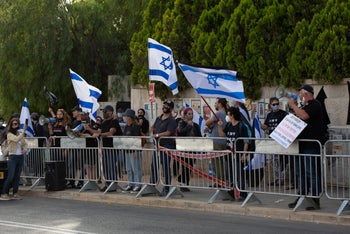 Members of Israel's 'Black Flag' protest movement demonstrate in front of Prime Minister Benjamin Netanyahu's residence, May 3, 2020.