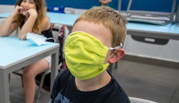 A student at the Cramim elementary school in Jerusalem on the first day back after the coronavirus lockdown, May 3, 2020.