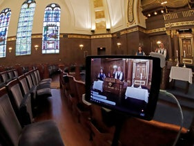 Pittsburgh's Rodef Shalom Rabbi Aaron Bisno delivers his sermon to an empty synagogue, during an Erev Shabbat service streamed live on Facebook. March 20, 2020
