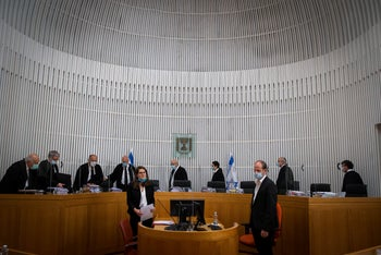 An extended panel of High Court judges enters the chamber to hear petitions against Netanyahu-Gantz coalition, May 4, 2020.