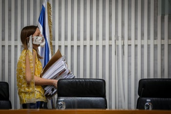 Documents being brought to the justices during a High Court session discussing petitions against the Gantz-Netanyahu coalition deal, Jerusalem, May 4, 2020.