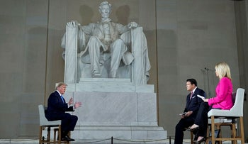 U.S. President Donald Trump is interviews by hosts with hosts Bret Baier and Martha MacCallum during a Fox News Channel virtual town hall
