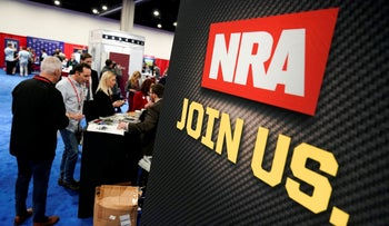 Attendees sign up at the NRA booth at the Conservative Political Action Conference annual meeting, Maryland, February 27, 2020