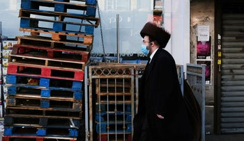 An Orthodox Jewish man walks through the Borough Park neighborhood of New York on the eve of the Passover holiday, April 08, 2020