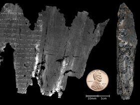 The virtually unwrapped Ein Gedi scroll compared to the size of a penny. The original scroll is on the right.