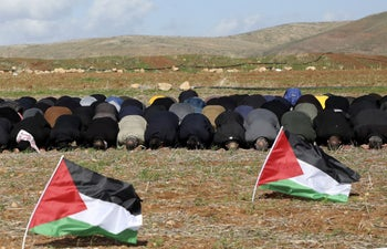 Palestinian protesters perform Friday prayers during a protest against the Trump Middle East peace plan, outside the West Bank village of Tamun near the Jordan Valley. Jan 31, 2020