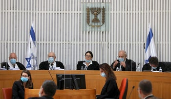 A panel of judges of the Israeli Supreme Court address a discussion on a petition asking whether Netanyahu can legally form a government, in Jerusalem, on May 4, 2020.